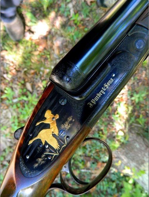 Gold embellished Purdey 10ga shotgun.