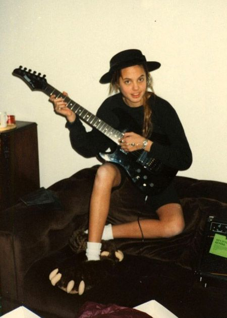 Angelina Jolie, in her teens.  When she was 15, Mick Jagger was already trying to catch her eye...!