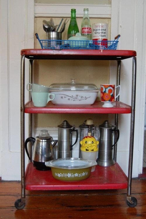 Vintage kitchen cart - yes, we had one.  Ours was all white.  WHO thinks having a rolling cart to move random crap around the kitchen is a good idea??  PUT IT AWAY!!