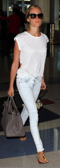 Who made  Kristin Cavallari's white cut out top, skinny blue jeans, gray handbag, black sunglasses, and nude flat sandals?