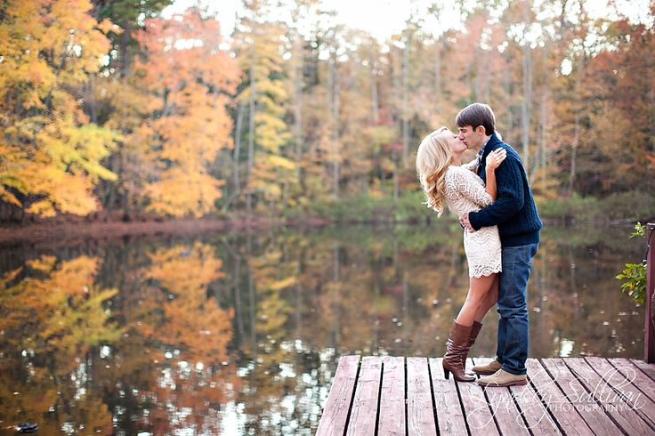 Cute Fall Engagement Photo. Need to find a lake or something with colorful trees surrounding