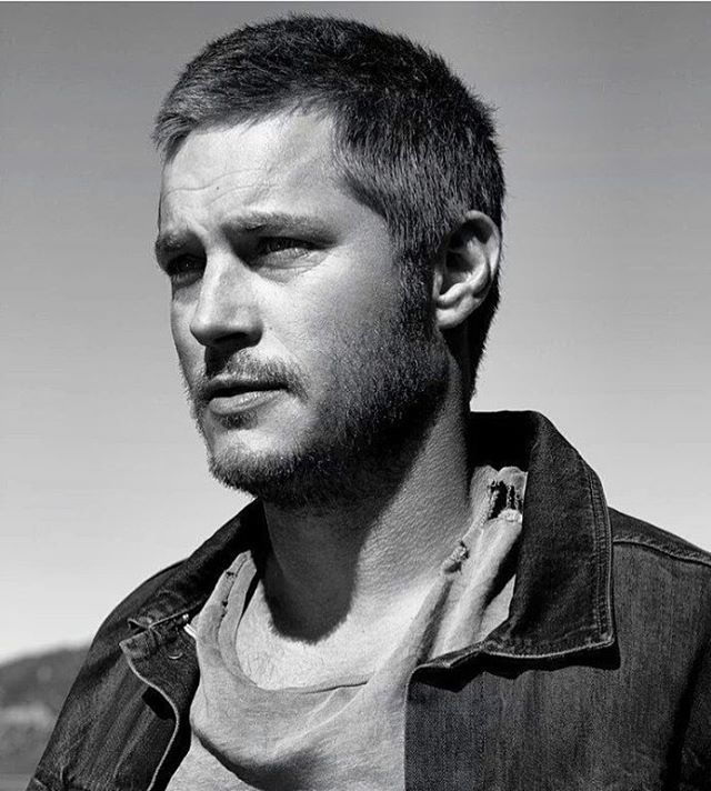 Pin for Later: If You Love Charlie Hunnam and Don't Know About Travis Fimmel, You're Missing Out Talk about a (gorgeous) chameleon.
