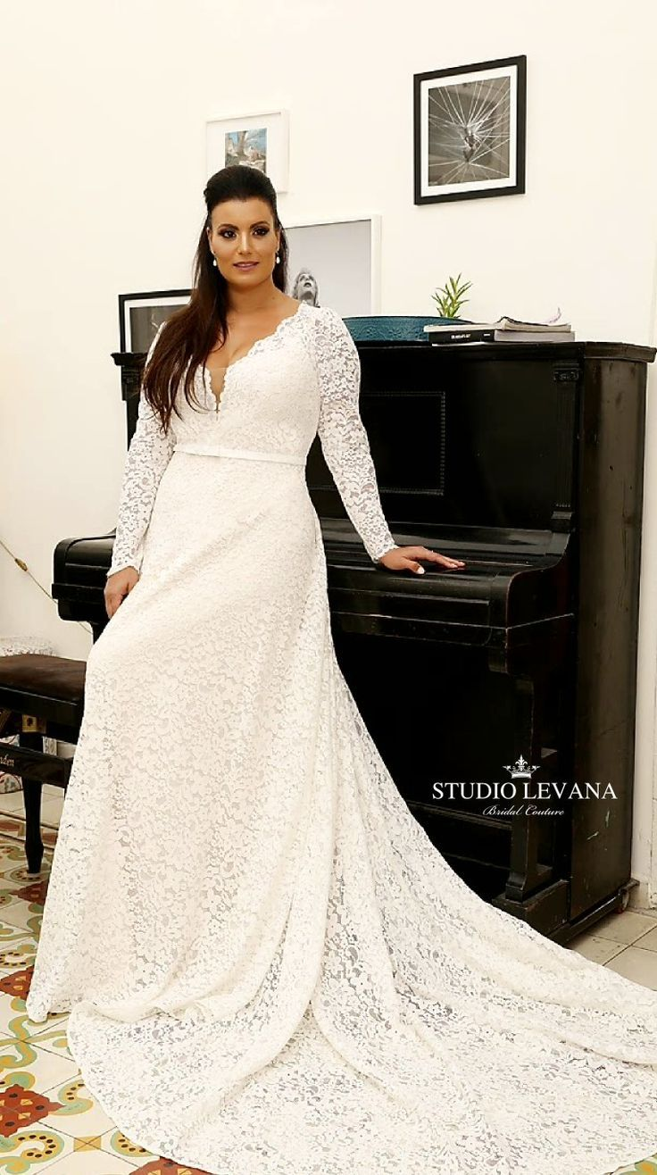 b5ce79eae7981 Elegant plus size full lace wedding gown with a line skirt with long train  and long lace sleeves. Seline. Studio Levana