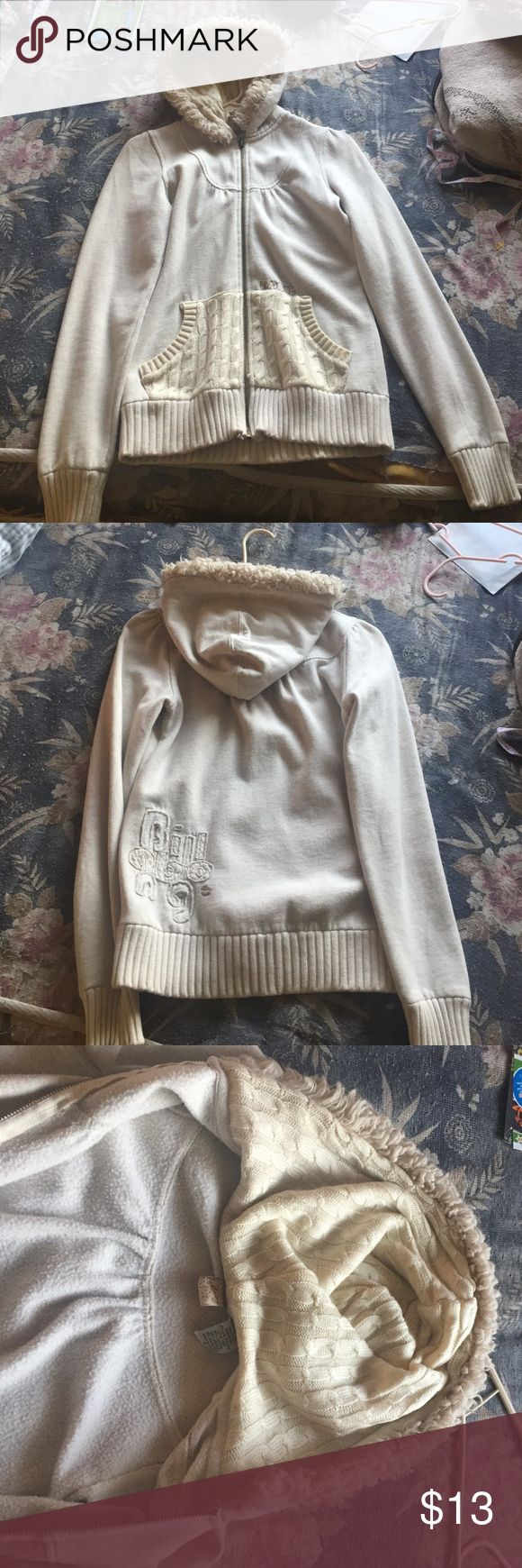 Fleece style zip up sweater Cream colored zip up hoodie with crochet pockets and inner hoodie. A bit thin material but very comfortable over all. Faux fur hoodie lining, 62% cotton, 23% acrylic, 15% polyester. Great for fall and winter. Billabong Jackets & Coats