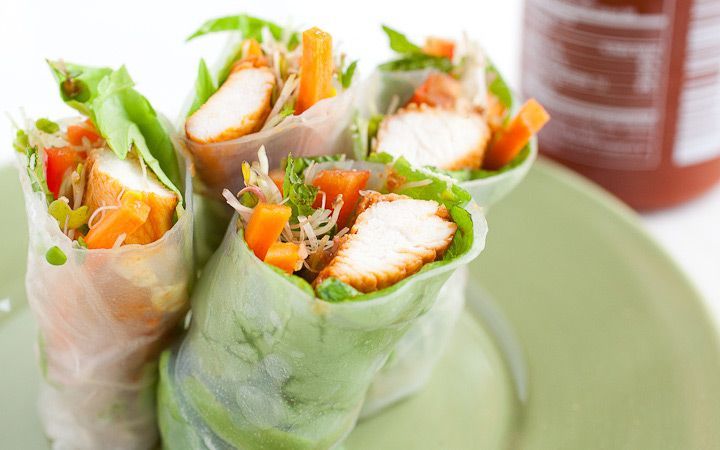Chicken spring rolls seasoned with loads of garlic and sriracha and rolled with bunches of fresh vegetables. This works great for a meal or appetizer!