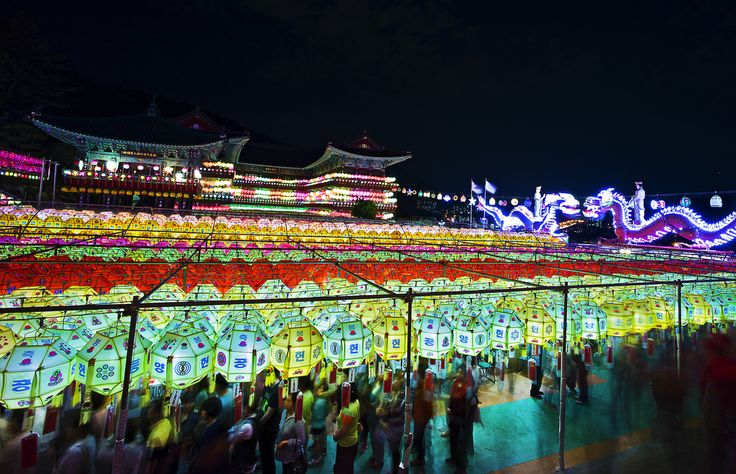 https://flic.kr/p/v2L4qp | From Under The Lanterns | Leica M9p Voigtlander 15mm 4.5 II   Illuminated Buddhist lanterns as seen from the crowded courtyard of Samgwang Temple in Busan.   www.mattmacdonaldphoto.com