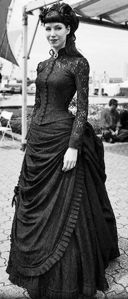 I like the lace sleeves of the dress and the fact that it looks so dark against her skin