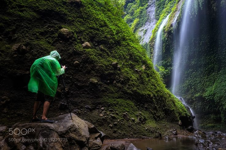 Man Standing In Front Of Waterfall. by PhongthornPoolruang from http://500px.com/photo/215227775 - Madakaripura waterfall located in Sapih village Lombang district and it is not far from Bromo area. Madakaripura is a sacred visiting area comprising lines of waterfalls where its center reaches a height of 200 meters from the bottom. This waterfall has related historic with a great Prime Ministry Gajah Mada who strongly struggled to unify the whole territory of the nation under span of control…