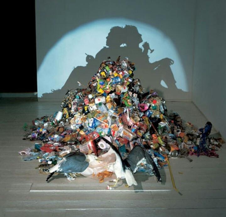 Shadow art: Trash pile into art