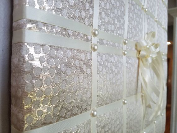 This luxurious French memo board in ivory & soft gold makes a perfect accessory at a wedding and after, to display your favorite photos, cards and other mementos of that special day. This would make a wonderful bridal shower gift! Or use as lovely, one of a kind soft bedroom decor. Hand made with metallic colored fabric, satin ribbon and faux pearls, this board measures 20x20in (approx. 50x50cm). My memo boards and fabric pictures are carefully handcrafted using high quality materials, ...
