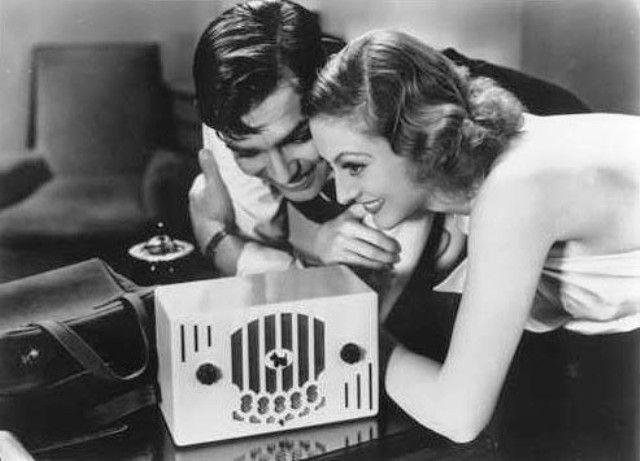 Clark Gable & Joan Crawford listening to the radio