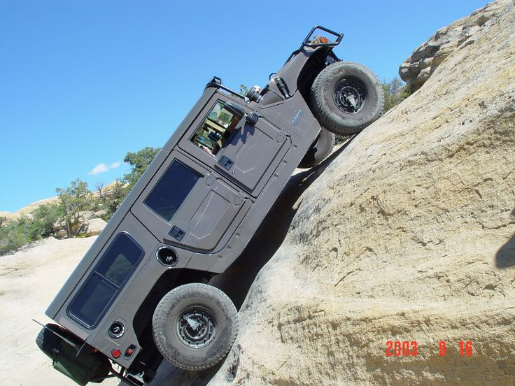 Hummer H1 - BEST vehicle EVER!!! If I ever get one....I would find a way to climb rocks everyday!!!
