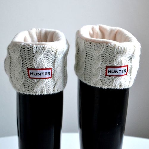 Hunter rain boots w/ sweater cuffs.