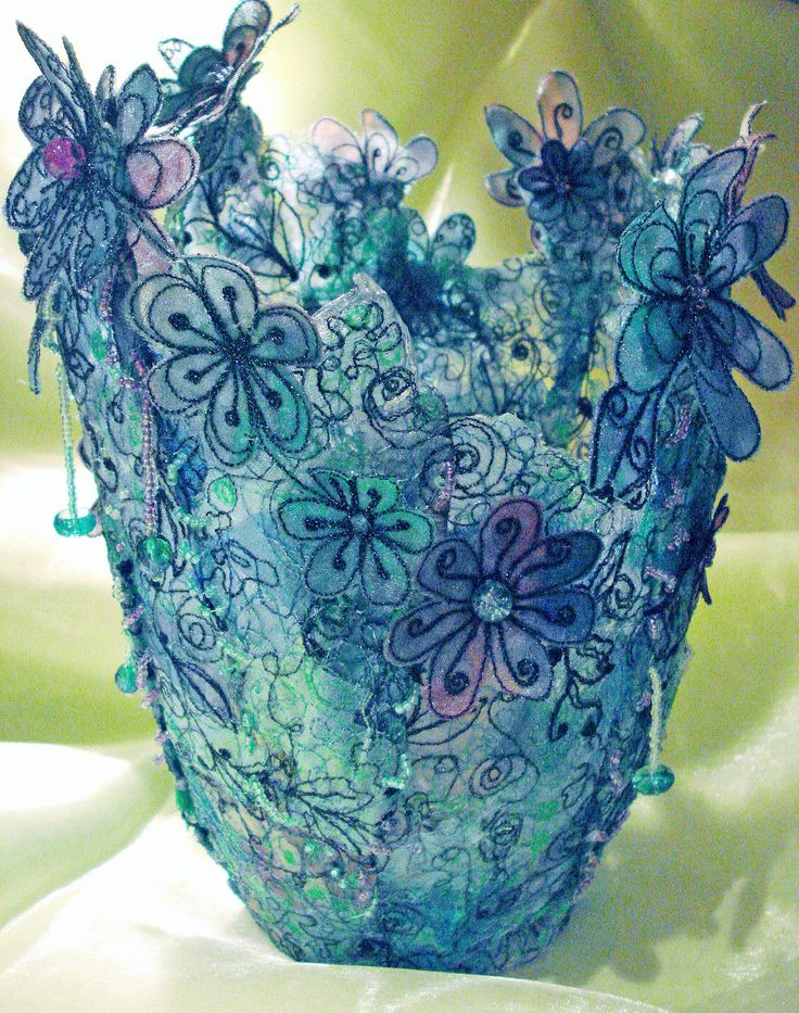 Kathleen Laurel Sage uses machine embroidery, organza fabrics, water soluble and a soldering iron to make 3D vases, floral panels and fashion items.