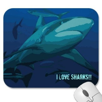 "An awesome mousepad with a reef shark and the tag ""I love sharks"""