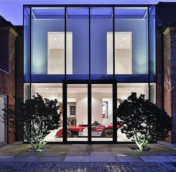 Just bought a bachelor pad? That's cute. See the English estate which houses a Ferrari in the living room.