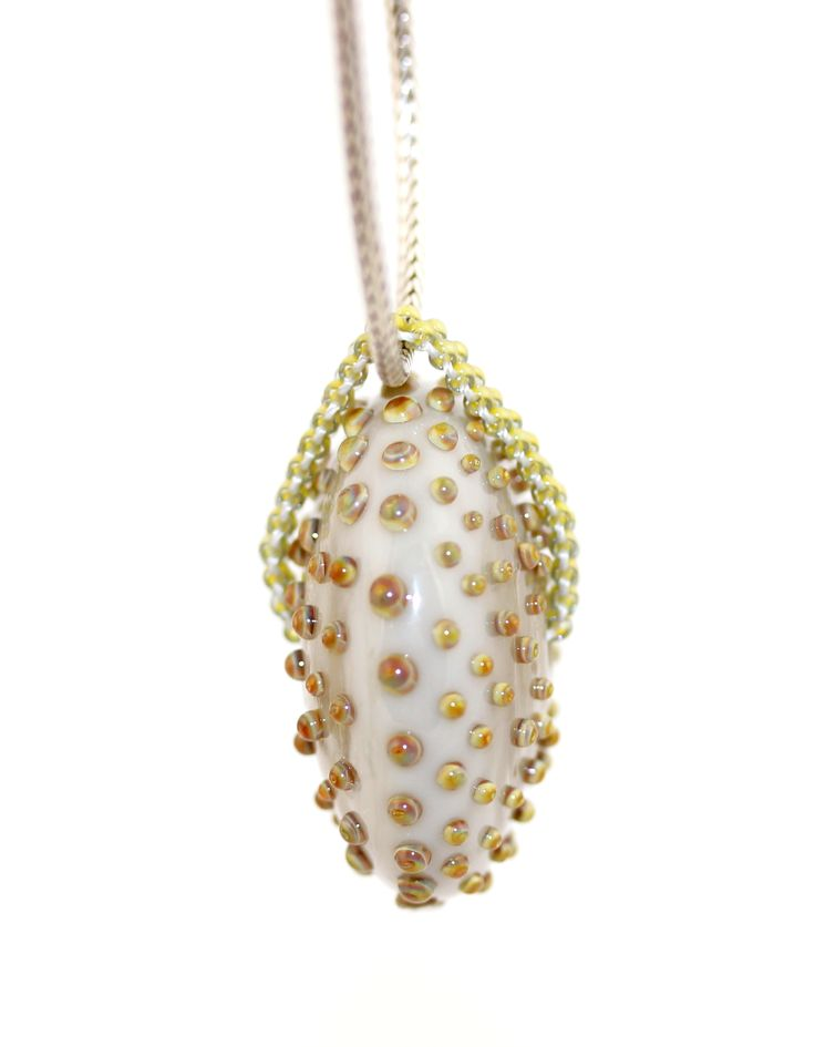 Dotted glass bead with a beaded loop.