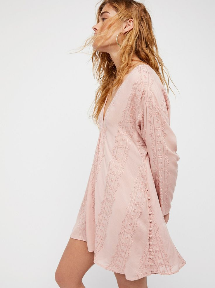 Sea Breeze Top | Soft and femme, this lovely long sleeve top features floral embroidery throughout. Side button closures create simple vents. V-neckline. Sheer fabrication.