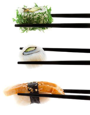 black lacquer chopsticks, white backdrop. backlight. minimalist.