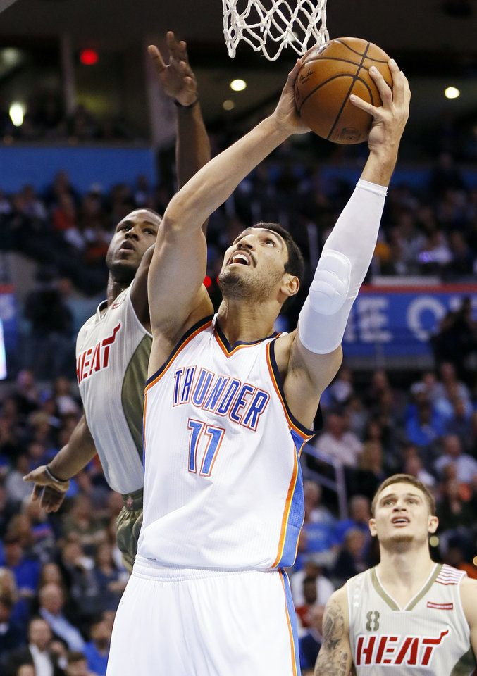 Oklahoma City's Enes Kanter (11) shoots between Miami's Dion Waiters (11), left, and Miami's Tyler Johnson (8) during an NBA basketball game between the Oklahoma City Thunder and the Miami Heat at Chesapeake Energy Arena in Oklahoma City, Monday, Nov. 7, 2016. Photo by Nate Billings, The Oklahoman
