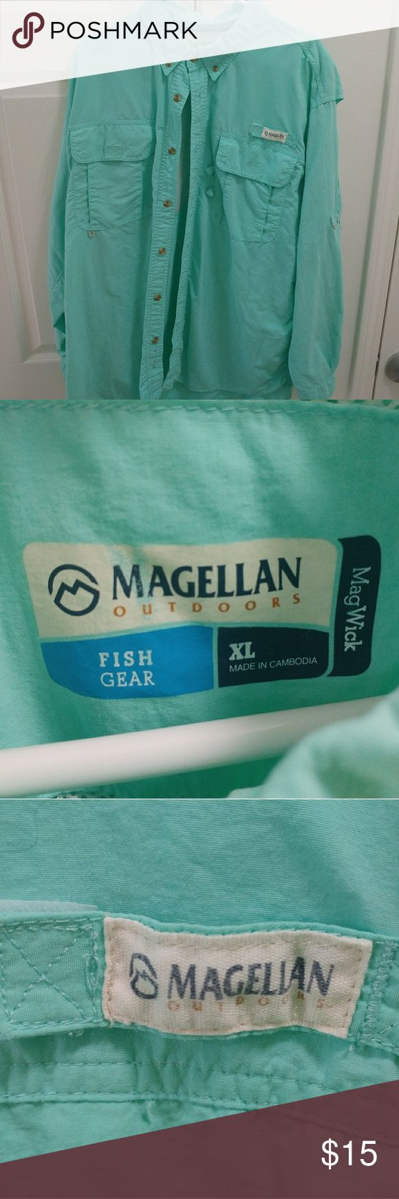 Magellan Outdoors Men's Long-Sleeve Fishing Shirt Be (implied huntin'), fishin', and lovin' every day with this Magellan Outdoors fishing shirt! It's in excellent condition and has never been used for fishing, so the pockets are in good shape. The fit is also true-to-size. These are like PFG shirts, but a better value, so if you want a nice fishing shirt or just something teal, this is right for you! Columbia Shirts Casual Button Down Shirts
