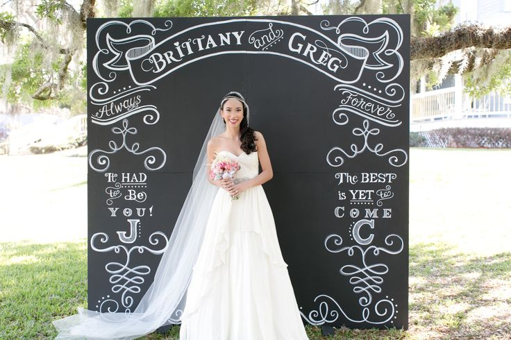 Big Chalkboard Backdrops are all the rage -- and this one is terrific! See more of this inspiration shoot on #smp right here: http://www.StyleMePretty.com/southeast-weddings/2014/04/18/raspberry-striped-wedding-inspiration/ -  AmalieOrrangePhotography.com | Inspiration Design by Table6Productions.com | Backdrop: ChalkShopEvents.com