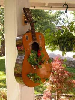 Any musicians out there? Creative and beautiful use for an old guitar!  #CompassPointeNC #Gardening #resortliving