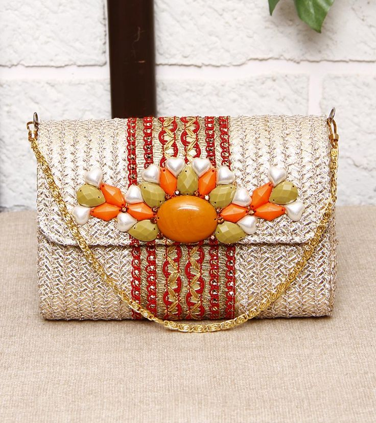 FALAH - Golden Clutch With Gota Work Click on the photo to shop it! :)