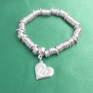 One Direction Loop Charm Bracelet One Direction Official Jewelry. $24.99. Stretchy bracelet. One Direction '1D' Logo Charm. OFFICIAL ONE DIRECTION MERCHANDISE. Save 14%!