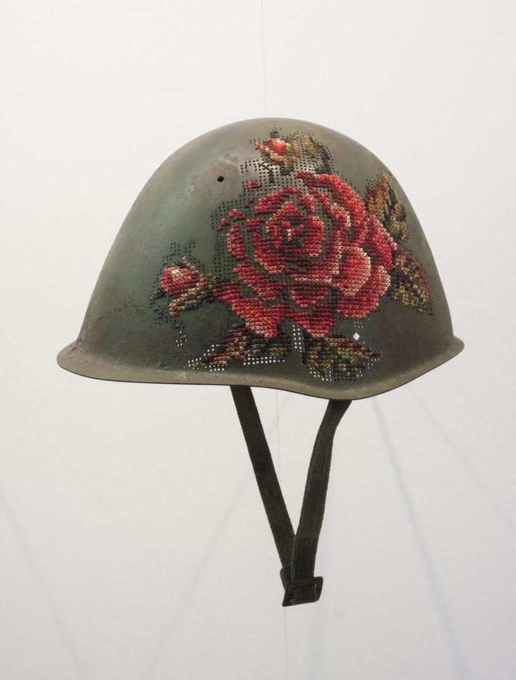Floral embroidery on Antique Soldiers' Helmets by Lithuanian artist Severija Inčirauskaitė-Kriaunevičienė