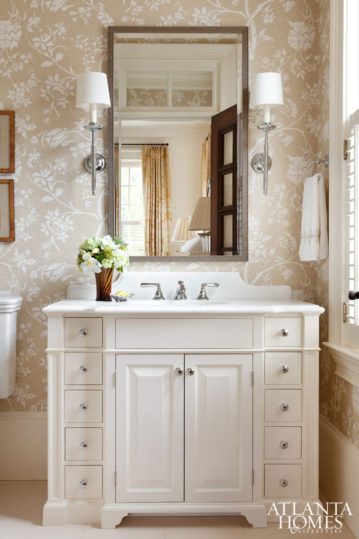The cream-colored palette contributes to the serenity of the bathroom.