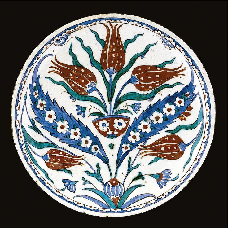 An Iznik polychrome rimless dish, Turkey, circa 1575