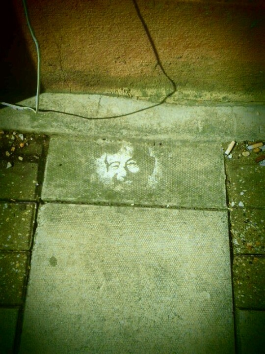 Face on the pavement, Hanover , Brighton