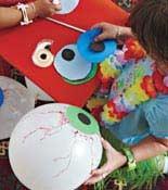 Kids making Halloween Eyes