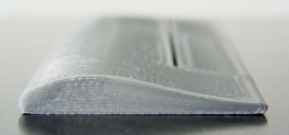 Non-planar layer Fused Deposition Modeling (FDM) is any form of fused deposition modeling where the 3D printed layers aren't flat or of uniform thickness