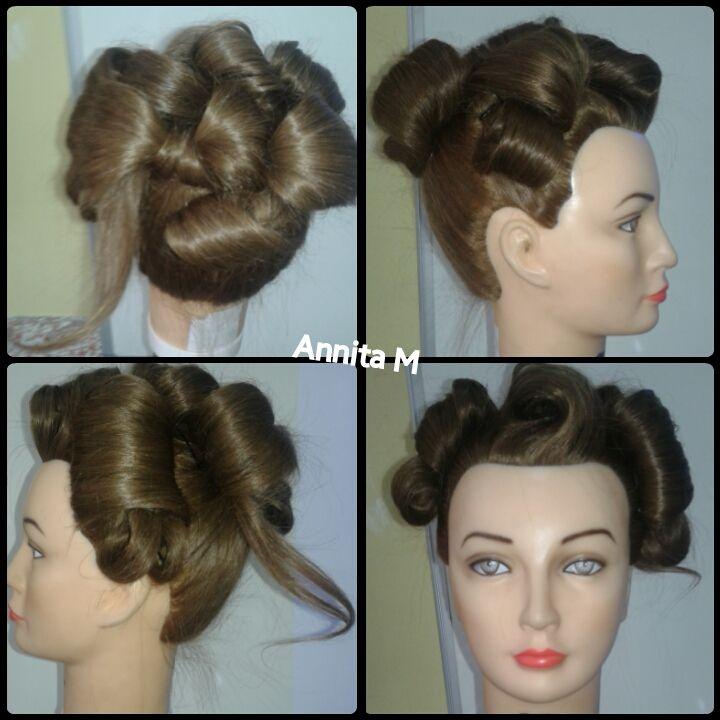 Recojido de epoca años 50 al estilo pin up, con bucles.