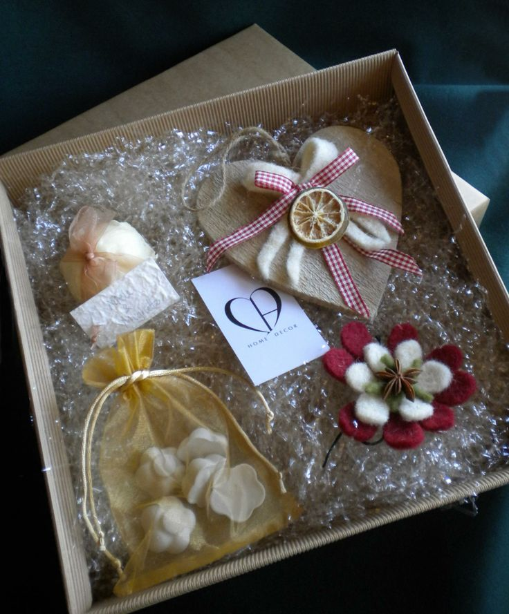 Gift boxes with Christmas creations (chalk scented wooden Christmas hearts, natural soaps, flowers Felt decorative for tree