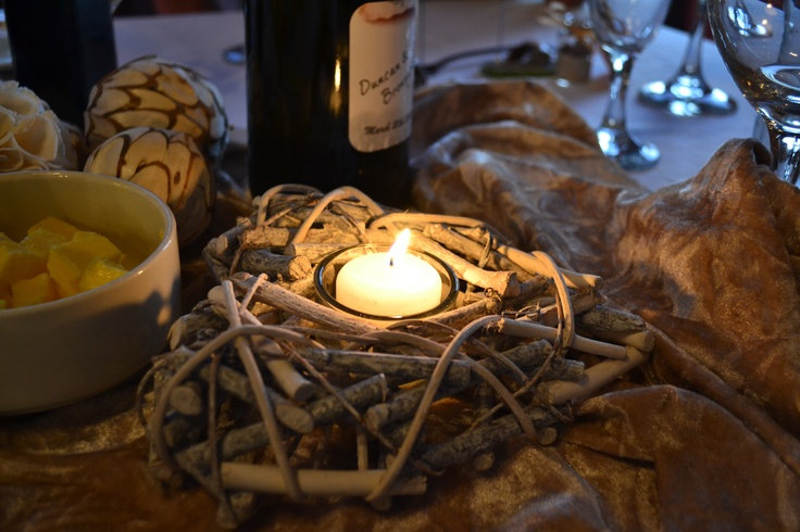Heart shaped candle holder for table made from small sticks and branches