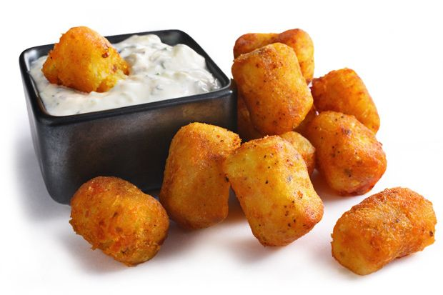 Indian-Spiced Potato Tots - Indian cuisine is full of tasty potato dishes. So it was only natural to pair these tater treats with the bold spices of the land of curry. A cooling cucumber-yogurt dip quells the cayenne kick.