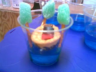 {baby moses snack}... blue jello, pretzel sticks, green gumdrop, sugar cookie, teddy bear, fruit rollup