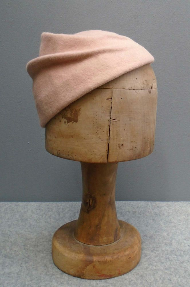 Pale ice cream pink fur felt hat with two decorative curved folds to the crown