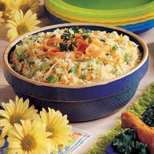 Baked Rice Pilaf Recipe -I'm always in search of inexpensive yet delicious like this one to serve at potlucks. This fluffy rice dish tastes as good as it looks.—Sheree Feero, Golden, Colorado
