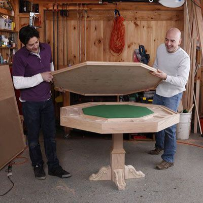 men assembling poker table