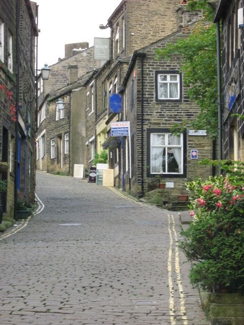 Main street, Haworth,West Yorkshire I used to walk up and down this street as a kid :)