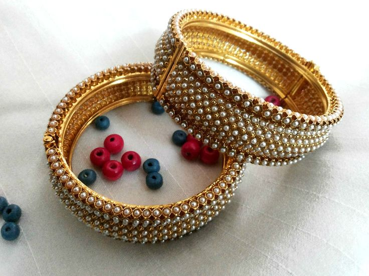 Royal Pearl bracelets in Golden finish only for Rs 2199 - Free Shipping.  Visit http://www.flea91.com/Bracelet/Pearl-Bracelet-Bangles-id-654835.html