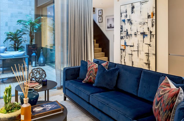 Robust in colour and brimming with personality, we used bespoke seating in rich Ashley Wilde Alaska Navy velvet and invigorative abstract art to reinforce the warm tones thoughout our historic Soho apartment scheme.