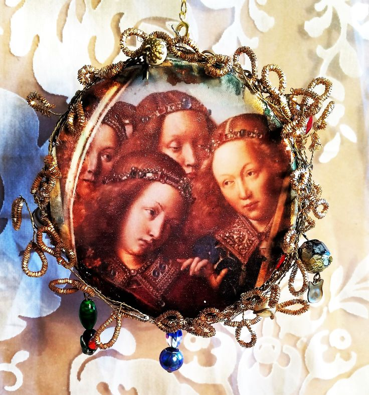 Three angels on a beaded circle