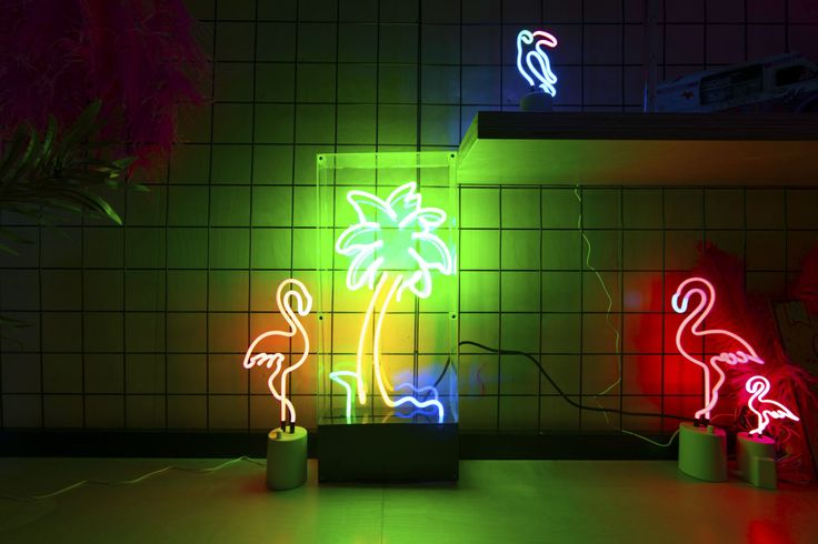 neon lights including flamingo, palm tree for a cool miami beach vice theme event