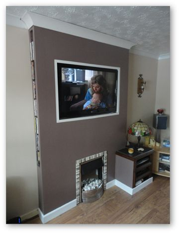 False chimney breast built to house flat TV, fire, consoles and DVD's.