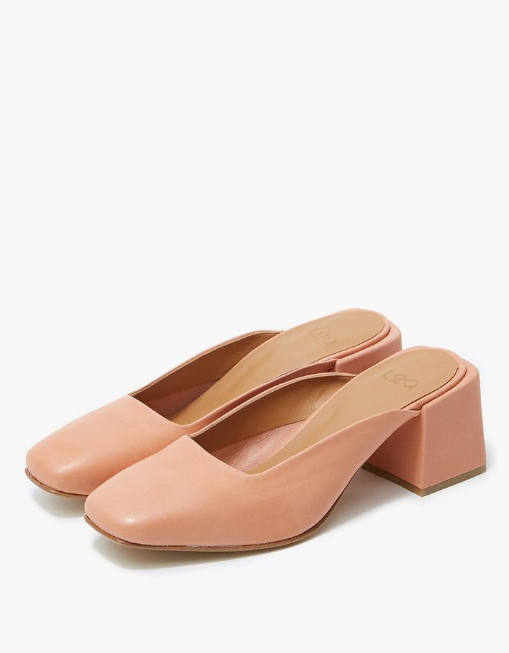 From LOQ, a squared toe slide in Mango. Lined cuff. Tonal stitching. Padded footbed with embossed logo. Covered heel with rubber cap.   • Leather upper • Leather sole • Made in Spain • Women's sizes listed